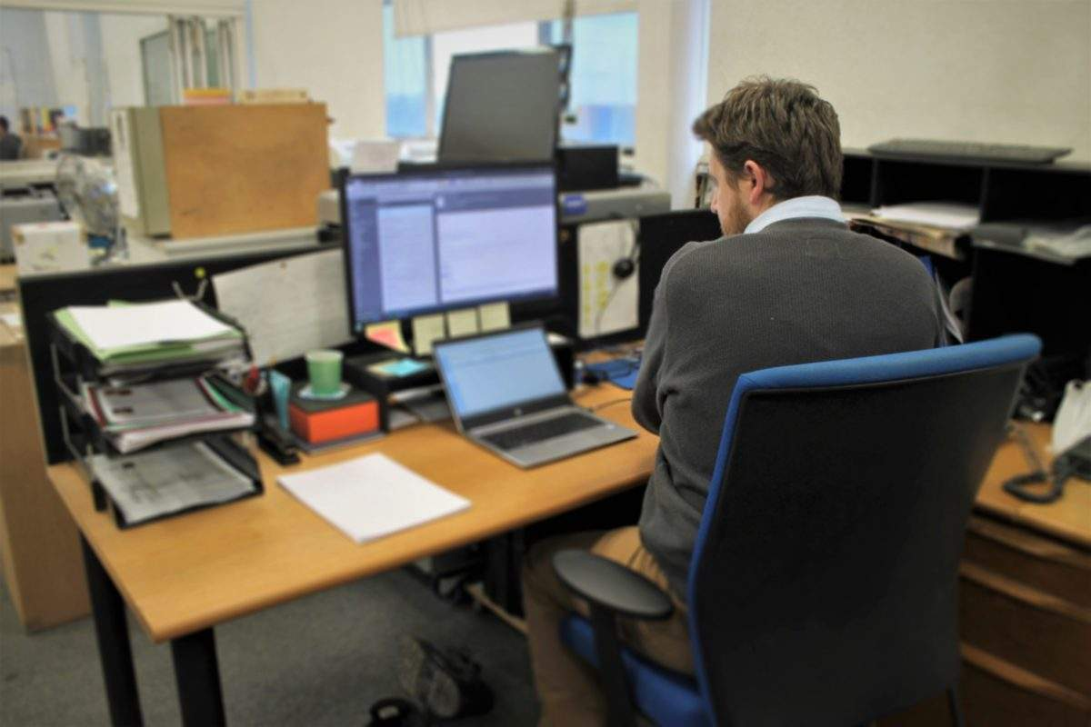 Stuart hard at work as his office desk - 1 -year milestone today